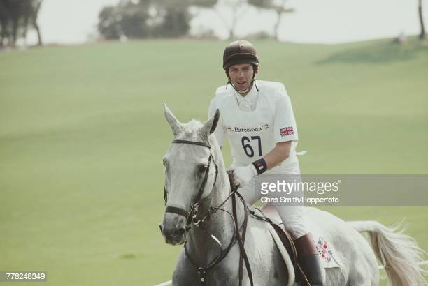 View of British equestrian Ian Stark of the Great Britain team in action riding Murphy Himself during competition in the cross country section of the...