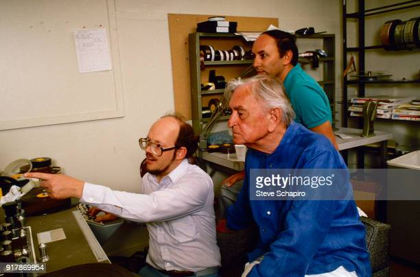 View of British film director David Lean and American film archivist Robert A Harris along with another man work at a KEM flatbed editor Los Angeles...