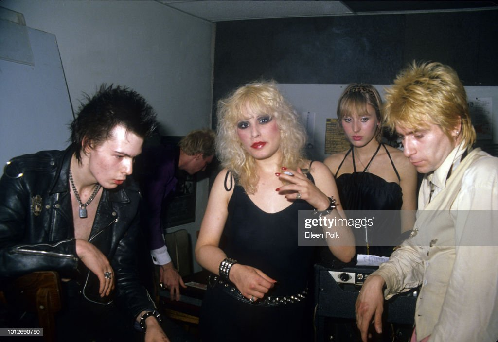View of British musician Sid Vicious (born John Ritchie, 1957 - 1979) and his American manager (and girlfriend) Nancy Spungen (1958 - 1978), model Esther Herskovits and her boyfriend, American musician Jerry Nolan, of the group the Idols, backstage at Max's Kansas City nightclub, New York, New York, September 1978. In the background is Nolan's bandmate Arthur Kane (1949 - 2004) (between Vicious and Spungen).