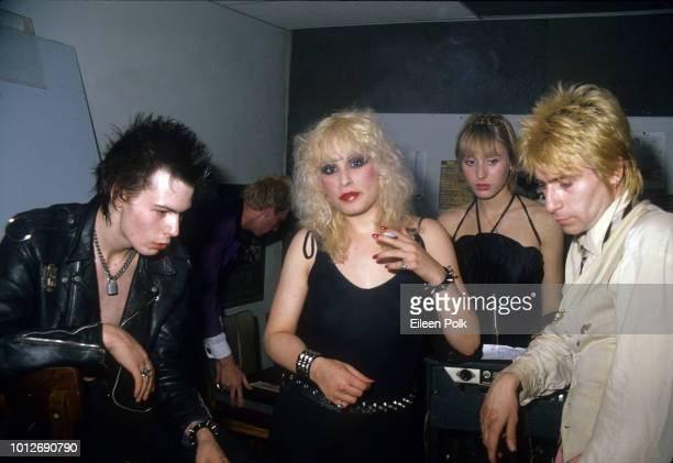 View of from left Rick Static Michele Robison and British musician Sid Vicious as they sit backstage at the Palladium New York New York November 12...