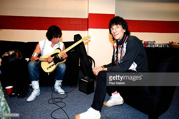 View of British musicians Jeff Beck and Ron Wood as they sit backstage at Eric Clapton's Crossroads Guitar Festival at Toyota Park Bridgeview...