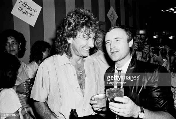 View of British Rock musicians Robert Plant and Phil Collins as they attend an after party at Greenwich Village's Be Bop Club New York New York...