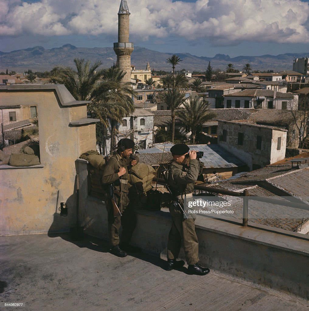 View of British soldiers on patrol, standing on the roof of a building in Nicosia, Cyprus on 15th February 1964 during ongoing Cyprus dispute hostilities between Greek and Turkish Cypriots.