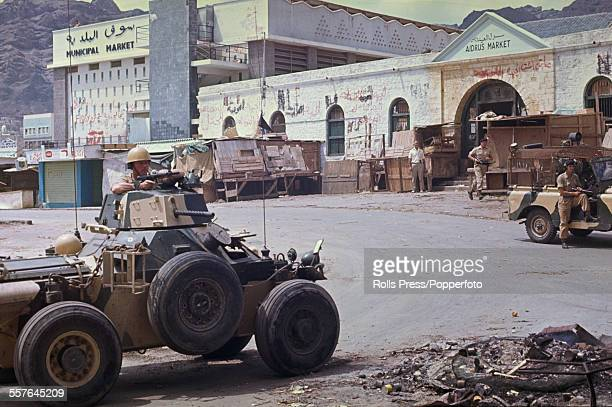 View of British troops with armoured Ferret Scout car and Land Rover on patrol on the streets of Aden town following a period of unrest and rioting...