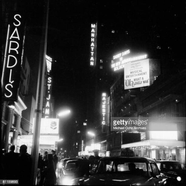 A view of Broadway from W 44th St outside Sardi's restaurant in Devember 1964 in New York City New York