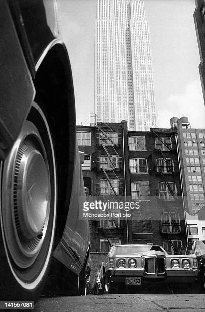 View of Brooklyn neighbourhood with cars and buildings. New York, 1969