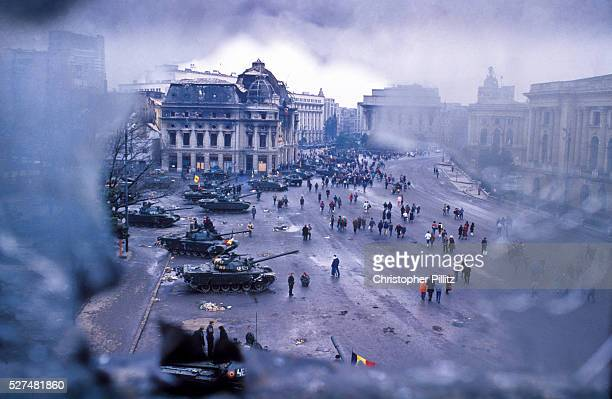 A view of Bucharest's central Square surrounded by tanks and bombed out buldings after the Romanian revolution ousted the dictator Ceucescu from...