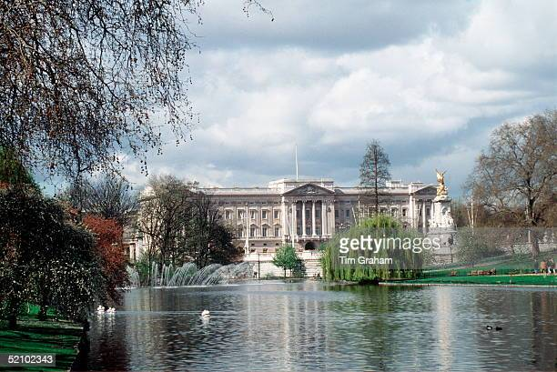 View Of Buckingham Palace From The Lake In St James's Park With The Queen Victoria Memorial On The Right