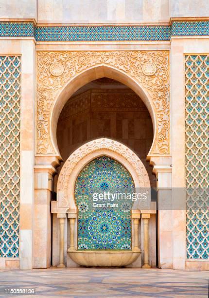view of building detail tiled. - mosquée photos et images de collection