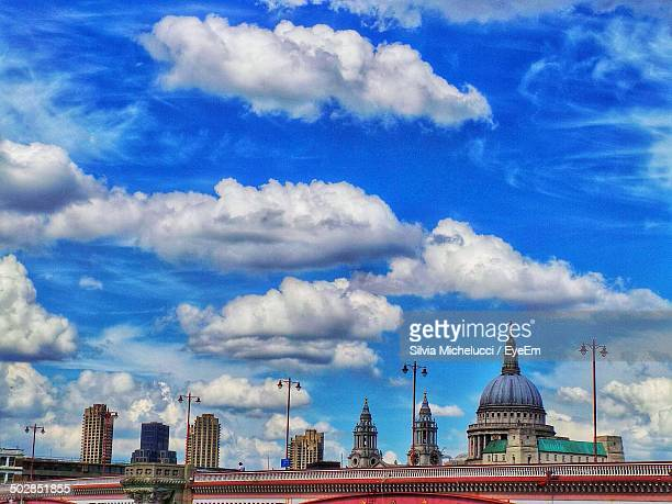 View of buildings against blue sky and clouds