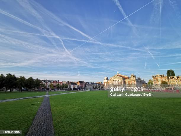 view of buildings against blue sky - museumplein stock pictures, royalty-free photos & images