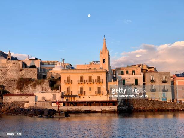 view of buildings against blue sky - isole eolie foto e immagini stock
