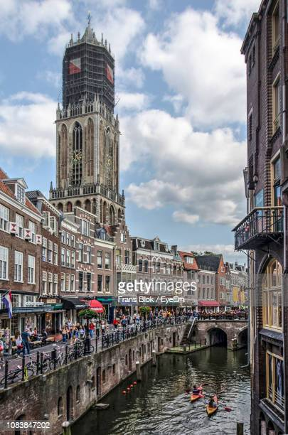 view of buildings against cloudy sky - utrecht stock pictures, royalty-free photos & images