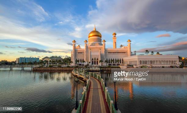 view of buildings against cloudy sky - bandar seri begawan stock photos and pictures