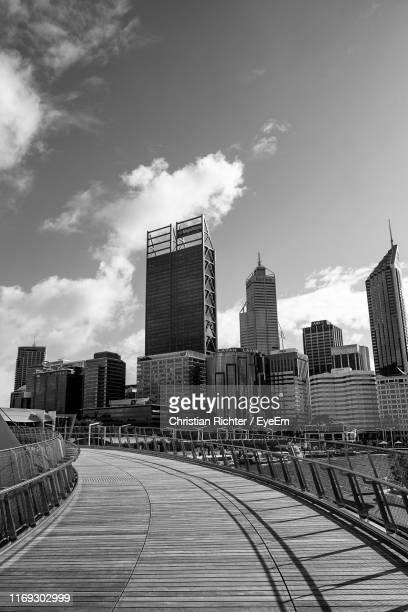 "view of buildings against cloudy sky - ""christian richter"" stock pictures, royalty-free photos & images"
