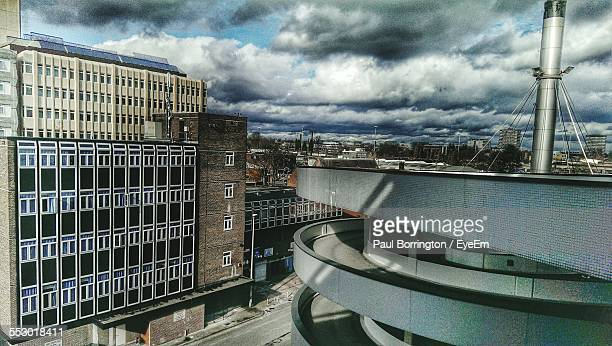 view of buildings against cloudy sky - coventry stock pictures, royalty-free photos & images