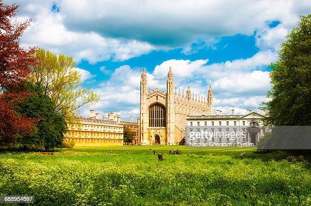 view of buildings against cloudy sky - cambridge england stock pictures, royalty-free photos & images