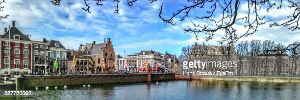 view of buildings against cloudy sky - the hague stock photos and pictures