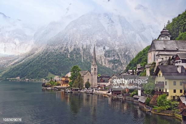 view of buildings against mountain - upper bavaria stock photos and pictures