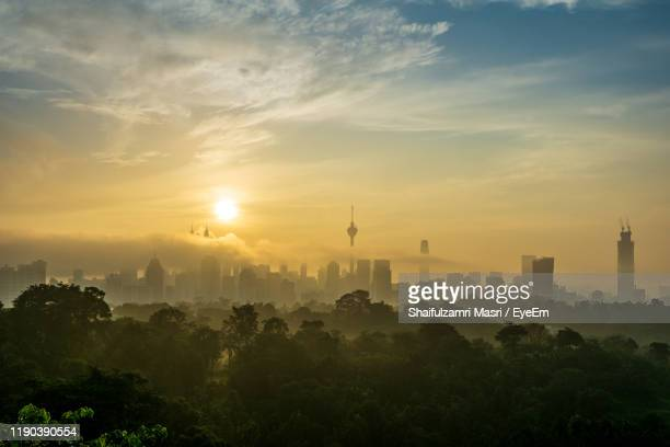 view of buildings against sky during sunset - shaifulzamri eyeem stock pictures, royalty-free photos & images