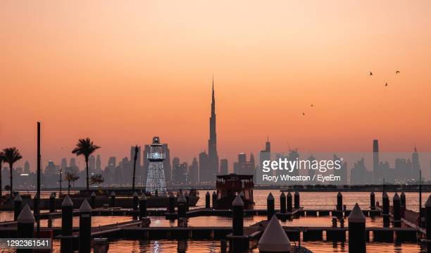 view of buildings against sky during sunset - dubai stock pictures, royalty-free photos & images