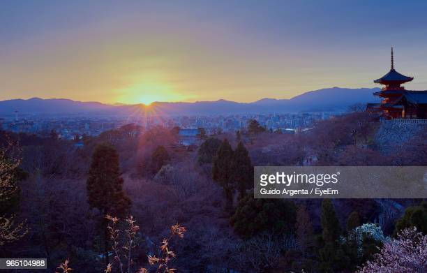 view of buildings against sky during sunset - kyoto prefecture stock pictures, royalty-free photos & images