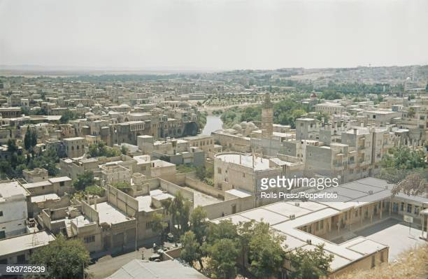 View of buildings and mosques lining the banks of the Orontes River flowing through the centre of the city of Hama in Syria in December 1971