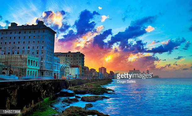 View of buildings and sea during sunset in Cuba