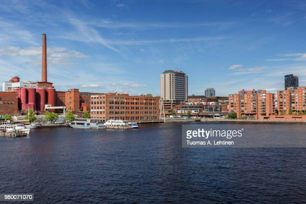 view of buildings and tourist boats at the ratinan suvanto, body of water, in downtown tampere, finland, on a sunny day in the summer. - タンペレ ストックフォトと画像