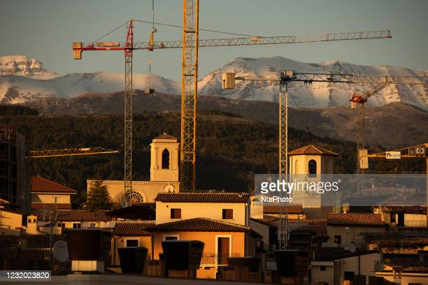View of buildings and tower cranes in L'Aquila on March 25, 2021. The 12th anniversary of the L'Aquila earthquake will be marked on 06 April 2021,...