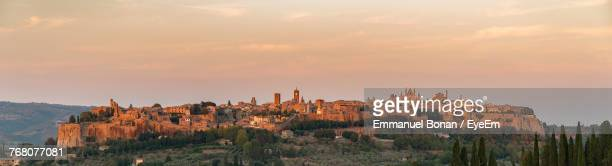 view of buildings at sunset - orvieto stock pictures, royalty-free photos & images