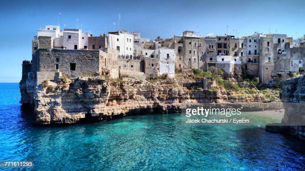 view of buildings at waterfront - bari stock photos and pictures