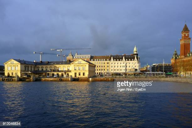 view of buildings at waterfront - helsingborg stock pictures, royalty-free photos & images