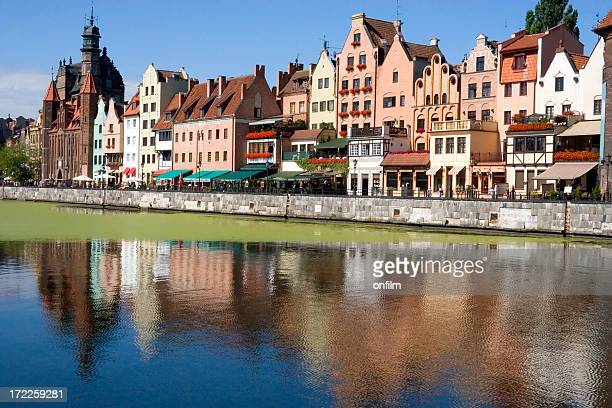view of buildings from across a lake in gdansk, poland - motlawa river stock pictures, royalty-free photos & images