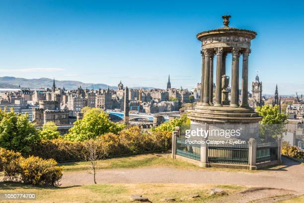 view of buildings in city against clear blue sky - edinburgh castle stock pictures, royalty-free photos & images
