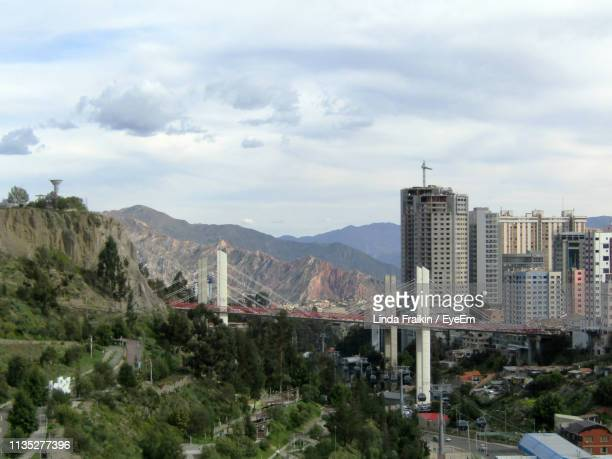 view of buildings in city against cloudy sky - linda fraikin stock pictures, royalty-free photos & images
