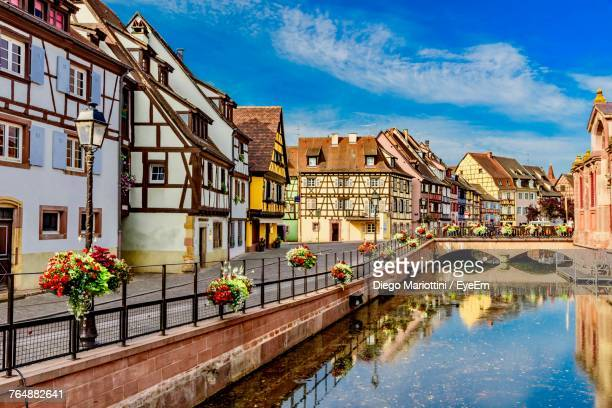 view of buildings in city against cloudy sky - colmar stock photos and pictures