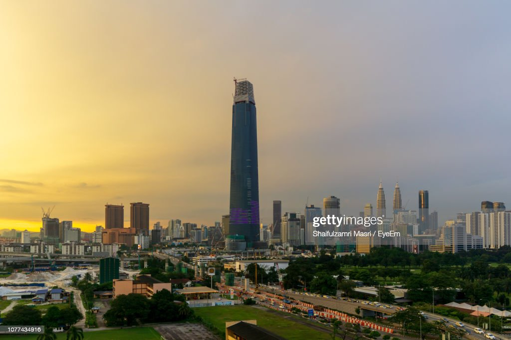 View Of Buildings In City At Sunset : Stock Photo