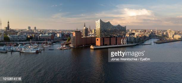 view of buildings in city at waterfront - amburgo foto e immagini stock