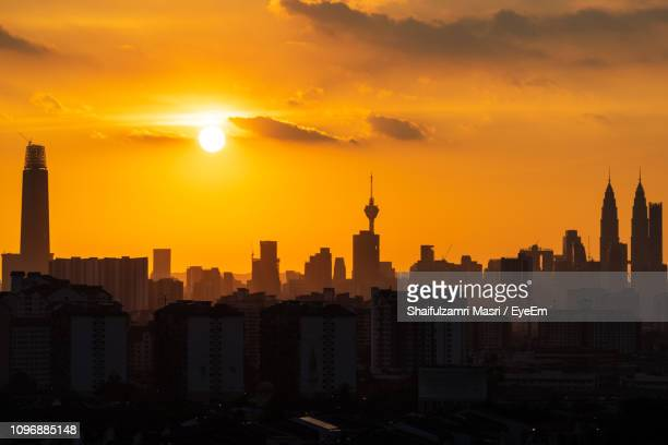 view of buildings in city during sunset - shaifulzamri ストックフォトと画像