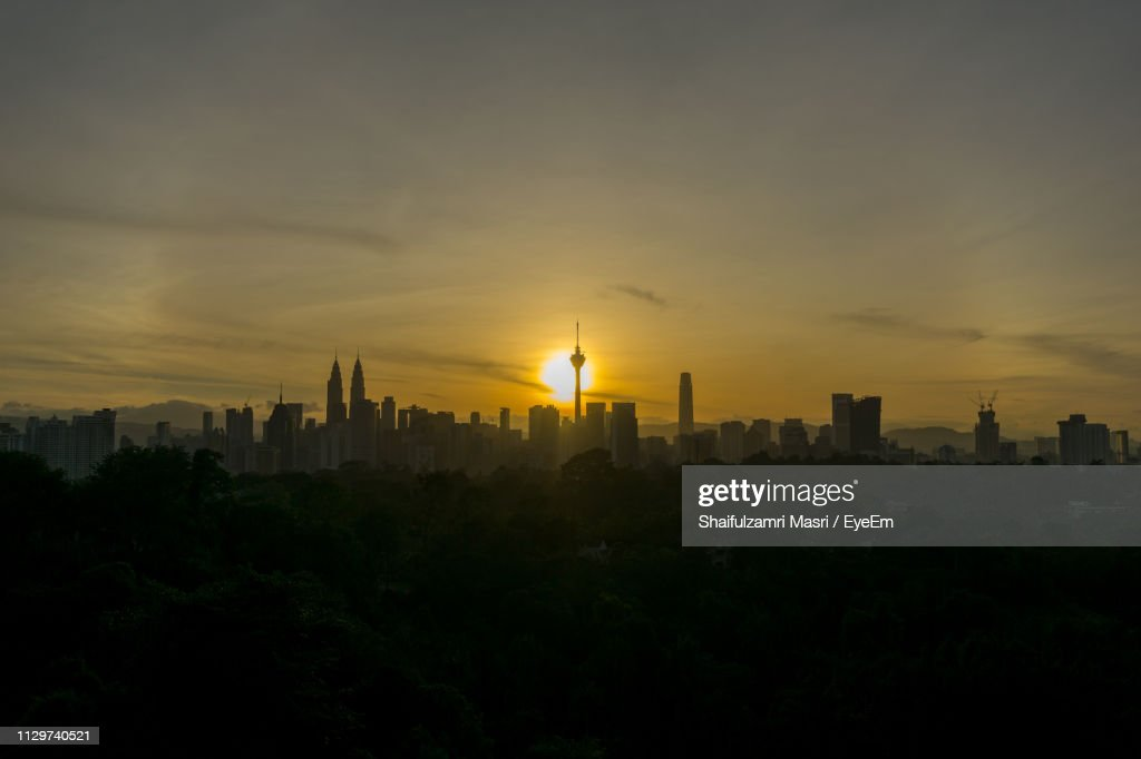 View Of Buildings In City During Sunset : Stock Photo