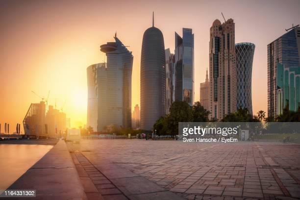 view of buildings in city during sunset - doha stock pictures, royalty-free photos & images