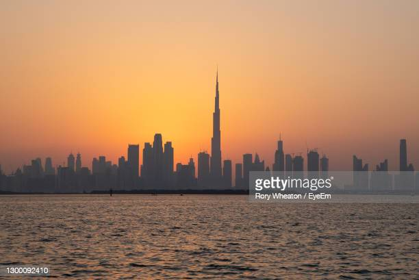 view of buildings in city during sunset - dubai stock pictures, royalty-free photos & images