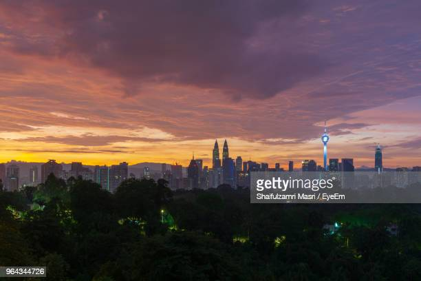 view of buildings in city during sunset - shaifulzamri stock pictures, royalty-free photos & images