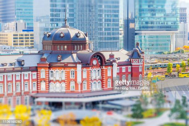 view of buildings in city - tokyo station stock photos and pictures