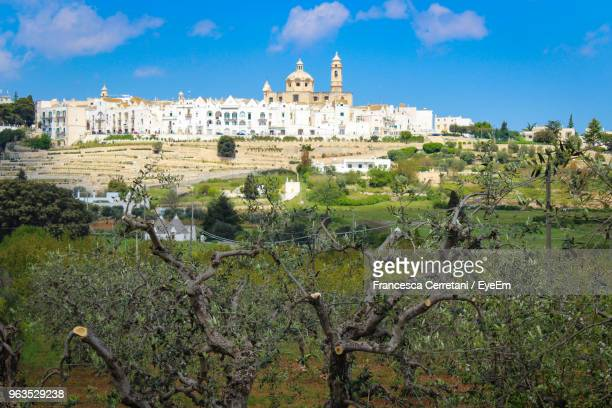 view of buildings in city - locorotondo stock photos and pictures