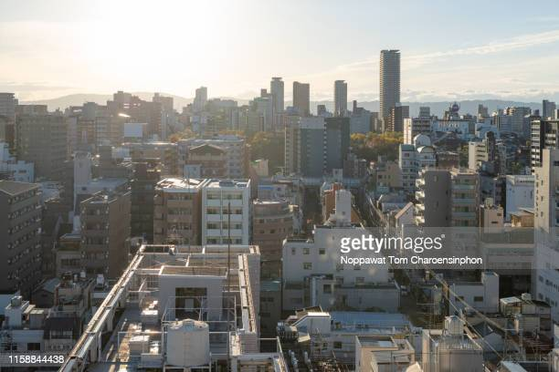 view of buildings in osaka during sunrise, kansai japan - morning ストックフォトと画像