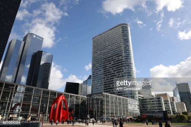 A view of buildings in the La Defense business district in Courbevoie on October 3 2017 / AFP PHOTO / LUDOVIC MARIN