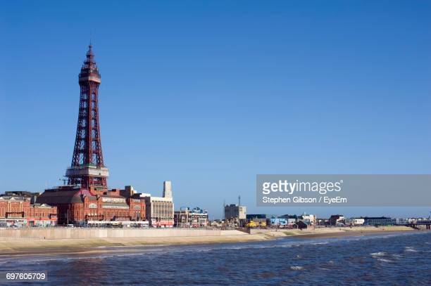 view of built structures against clear sky - blackpool stock photos and pictures