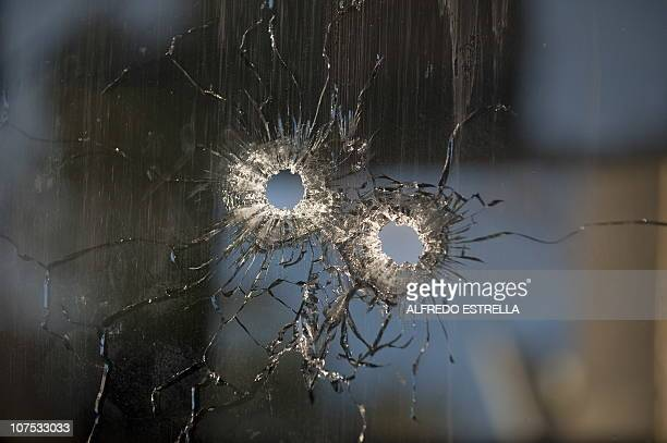 View of bullet holes in the window of a closed tollbooth at the MoreliaUruapan road in Michoacan State Mexico on December 11 2010 Gunmen from La...